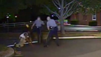 Video Shows White Officer Kicking Black Man in Face