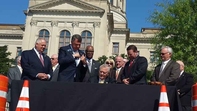 Deal signs $900 million transportation package into law