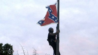 Activist Removes Confederate Flag From Monument