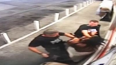 Woman Claims Cops Beat Her for Filming Husband's Arrest