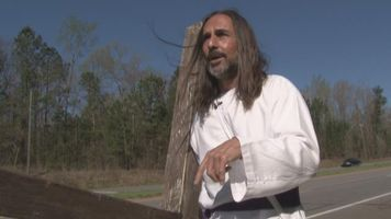 Ga. man takes his faith on the road, carries cross across state