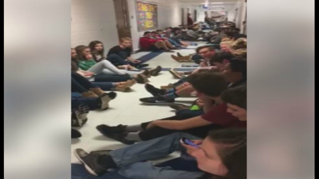 High School students sing to keep calm during storm warning