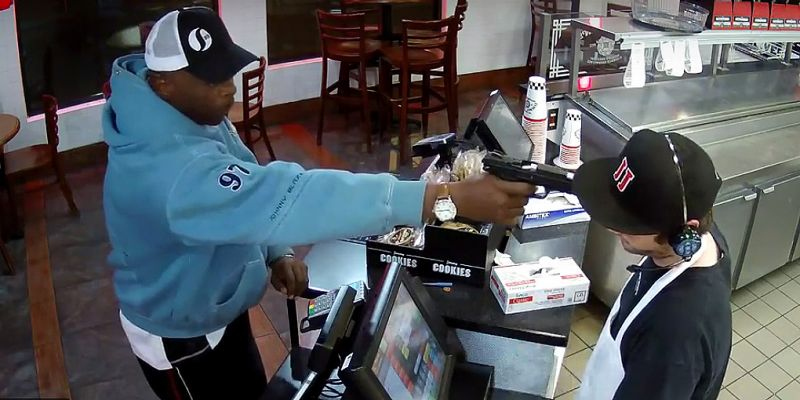 Crazy Video Shows Robber Put Gun To The Head Of An