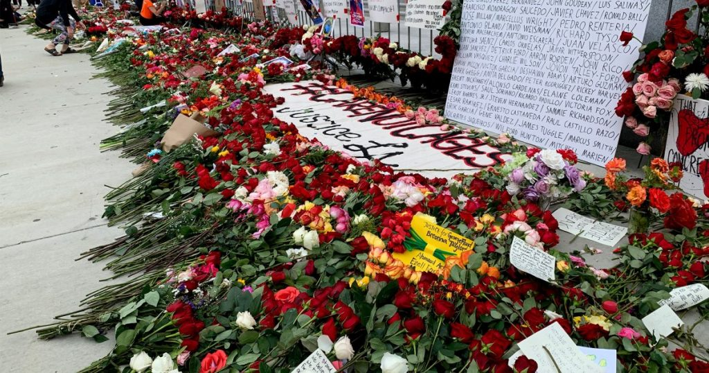 a-rose-that-grew-from-concrete:-protesters-leave-flowers-to-commemorate-those-who've-died-at-the-hands-of-police
